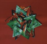 """Mathmatical"" origami... very impressive as gifts for the executive.  Order hanging or on a black base."